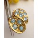 Anello in oro giallo 18kt con Topazi Azzurri - gr. 18